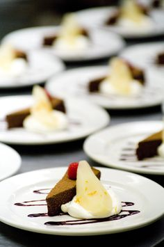 Elegant dessert for shower or reception.  Chocolate torte top with a single raspberry, paired with a brandied pear and creme fraiche. (no recipe, just put the three together!)