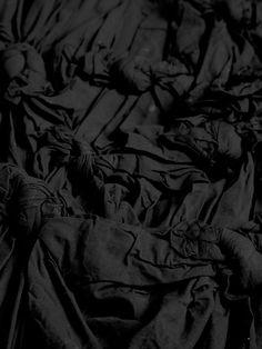 Detail of black knot kilt, comme des garçons