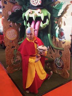 Entry #051: John Lawrence  Character: Aang, from Avatar: The Last Airbender and The Legend of Korra  John Lawrence shaved his head for this cosplay role.  Vote for this entry by liking, commenting, and sharing this post! Contest Details: https://www.facebook.com/MiccostumesCosplayShop/posts/996975130341783