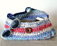 Upcycled  fabric crochet purse in blue and pink with vintage wooden round button