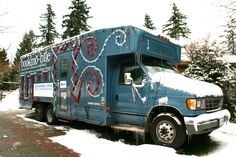 Coquitlam Public Library's [BC, Canada] Book Bus at Christmas, 2008 -- Post is about the history of this Book Bus; click through for a photo of Santa and a bunch of Rudolphs outside this decorated bookmobile.