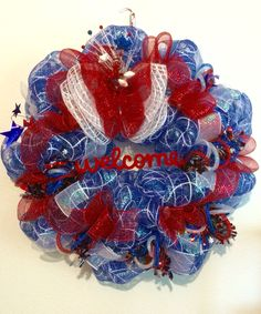 For sale $65 Patriotic deco mesh wreath. See more on our Facebook page laces crafty creations