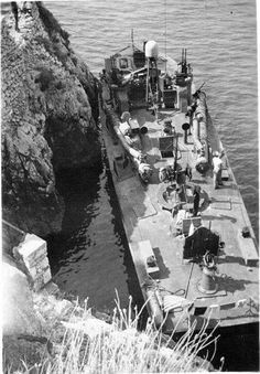 PT-215 a Higgins 78-footer of Motor Torpedo Boat Squadron 15 (MTBRon 15) tied up in Blue Grotto Capri Italy in Mar 1944.