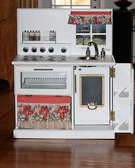 This is the play kitchen we made for Addy's 2nd Birthday.  We made this from an old TV stand that we got at Goodwill.  We used a lot of the great ideas we found here on Pinterest.