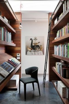 "Home library idea. Two parallel shelves creating the illusion of an ""aisle"" in a large space (and a reading space within)"