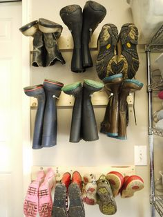 Inexpensive DIY boot and shoe storage from wood and lag bolts. I think this is a great way to store rain boots, snow boots, and messy shoes and I'm going to make one for our garage.