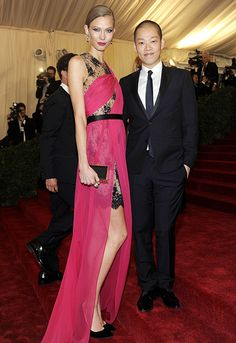 Karlie Kloss and Jason Wu at the Met 2012. Karlie wore a custom embroidered Chantilly lace dress with fuchsia chiffon drape with the Karlie box clutch by Jason Wu and velvet pump with gold piping by Jason Wu, paired with Van Cleef & Arpels jewelry.