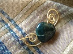 Gemstone heart brooch. Hand forged fibula with carved green Fancy Jasper heart.  Hand made  by CalicoRoseStudio.  £8.95.  check it out on Etsy.