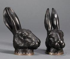 Pair of Wedgwood and Bentley Black Basalt Hare Head Stirrup Cups, England, 18th century, silver mounted rims.