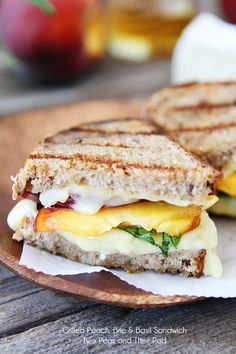 Grilled brie cheese sandwiches with peach slices, fresh basil, and a drizzle of honey. A simple summer sandwich with gourmet flavors! Brie Sandwich, Sandwich Recipes, Vegetarian Sandwiches, Panini Sandwiches, Chicken Sandwich, Wrap Recipes, Gourmet Recipes, Healthy Recipes, Eat Healthy