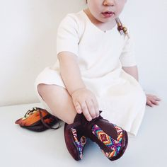 """Our Beaded """"Bing Cherry"""" Moccasins available at www.LLDesignsStore.com 100% Handmade, hand-beaded, made of premium supple deerskin leather. Perfectly soft for the precious lil toes #beadedmoccasins #moccasins #babymoccasins #beadwork #love #heirloom #LLDesigns"""