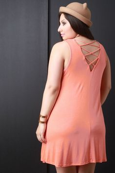Strappy-Back Sleeveless Shift Dress. This  plus size shift dress  features a scooped neckline, sleeveless design, plunging V back with a strappy cage inset, and high-low hemline. Accessories sold separately. 95% Rayon. 5% Spandex.Measurement   Size Bust Waist Hip Length   1X 19 23  31  35    2X 20  23.5  31.5  35    3X 21  24  32 35