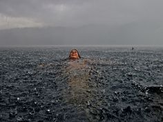 My sister in the south of Chile. We are sitting at home next to the fireplace in our southern lake house when it suddenly began to pour uncontrollably. Had to rush into the lake to take this snapshot! (Photo and caption by Camila Massu/National Geographic Traveler Photo Contest)