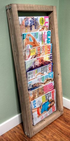20 DIY Magazine Rack Projects...why couldn't you space the rods a little farther apart and make a quilt rack?