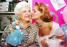 Barbie doll creator Ruth Handler, left, gets a kiss from Kristi Cooke, an actress dressed as a Barbie doll, during the 35th birthday celebration for the doll at FAO Schwartz in New York City on March 9, 1994. (AP Photo/Robert Clark) Photo: ROBERT CLARK