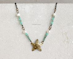 Collana con stella marina in ottone, perle di fiume e perle in vetro // Necklace with starfish in brass, freshwater pearls and glass beads #summer #handmade #jewelry #boho #style #sea #seaside #sealife #holidays #travel #wanderlust