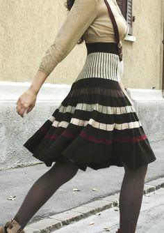 Shima Seiki. Love the skirt. Would not wear with suspenders.