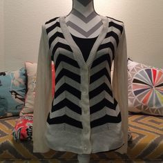 Cream and black chevron lightweight cardigan Love this beautiful cardigan sweater. Cream and black chevron print. Only worn twice, still in great condition. Tag has been removed from back (it was itchy), but it is a size medium. Sweaters Cardigans
