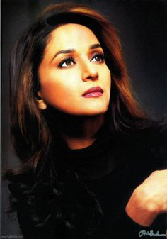 While writing the other post on Madhuri's first Jhalak appearance, I went on a stalking adventure, to find the best pictures that I liked, of Madhuri Dixit, the symbol of grace.
