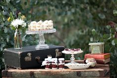 After seeing this dessert table inspiration by The Sunday Sweet I think I might need to sneak in dessert before lunch!  I can't help craving their scrumptious red velvet mason jar cupcakes, banana pudding and mini cherry pies.  Especially since they created this adorable dessert table with vintage and handcrafted charm to display all their tasty treats. […]