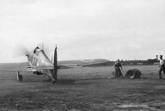Hurricane Mk I VY-Q, flown by S/L Peter W Townsend of No 85 Squadron RAF, taxies out at RAF Castle Camps in July 1940. On 11 July, flying VY-K, Townsend intercepted and severely damaged a Do 17, forcing it to crash-land at Arras. Return fire from the bomber hit the fighter's coolant system and Townsend was forced to ditch 20 miles from the English coast, being rescued by HM Trawler Cape Finisterre.