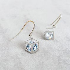 This unique earrings feature a faceted diamond shape Cubic Zirconia stone inside a tarnish resistant Silver plate cube on Sterling Silver .925AG hooks.   Cube is 6x8mm and diamond CZ is 8 mm.   Earrings measure 2.5cm including hooks.   A great gift for someone you love!   They come with an organza pouch, ready to be gifted and to store your jewelry.   Handmade with love & care.   See also the matching necklace…