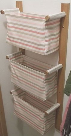 Wall hanging storage with 3 IKEA baskets, maybe i could DIY this since I haven't seen them at the Ikea store close to my house.Wall hanging storage with 3 IKEA baskets; no instructions on site. Could be made into a clothes hamper for a small space. Small Space Storage, Small Space Organization, Organization Ideas, Creative Toy Storage, Ikea Basket, Wall Hanging Storage, Hanging Baskets, Baby Clothes Storage, Diy Clothes