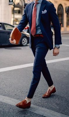 5 Must Have Suit Accessories for Every Man is part of Suit accessories - It's time to get out of the comfort zone and break the notion that a mainstream three piece suit with a tie will do NO! You need to embellish that suit attire Read on… Blue Suit Brown Shoes, Blue Suit Men, Man Suit, Blue Suits, Navy Blue Suit, Suit With Red Tie, Mens Suit Colors, Stylish Men, Men Casual