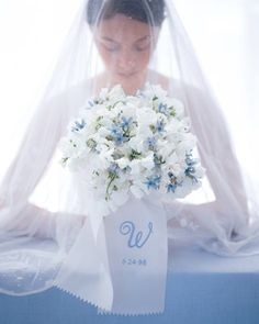 Bridal bouquet in simple, clean colors. Love the delicacy of the sweet peas and tweedia, the simple contrast of the shapes. Everything about this just says sweet and simple. From Best of Martha Stewart Living Weddings. Boquette Wedding, Blue Wedding, Floral Wedding, Dream Wedding, Wedding Veils, Wedding Stuff, White Wedding Bouquets, Bride Bouquets, Flower Bouquet Wedding