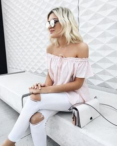 An off-the-shoulder blush top with white jeans and mirrored sunnies