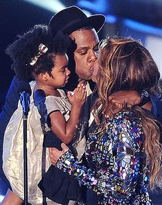 At the 2014 VMAs, Beyonce accepted the coveted Michael Jackson Video Vanguard Award from her husband, Jay Z, who made a rare public appearance with daughter, Blue Ivy. Taking a moment to kiss both her little girl and her husband, the superstar was overcome with emotion. Watch the heartwarming video here!
