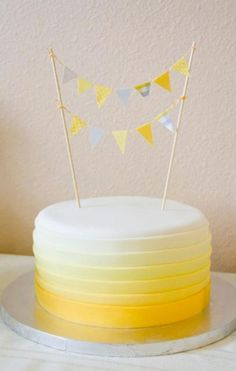 Geschenk Geburt - Round birthday cake with cicular yellow gradient bands and poles with triangle f. Round Birthday Cakes, Yellow Birthday Cakes, 20 Birthday Cake, Birthday Flags, Yellow Cakes, Birthday Ideas, Happy Birthday, Pretty Cakes, Cute Cakes