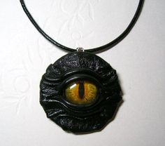 Black leather pendant with dragon eye.  Leather necklace with snake eye. Gothic fashion pendant.  Halloween necklace. - $20