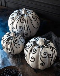 Paint your pumpkins white and bejewell them with either black jewel or black thumb tacks to make these hauntingly modern designs. Don't be surprised if you spot these on my dining room table this fall! Photo by