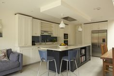 Higham - A painted shaker kitchen with hob on the island and ceiling extractor.  The island is painted in a contrast colour.