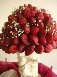 Strawberry bouquet. I wouldn't have a bouquet by the time I reached my future husband if I had this for a bouquet!