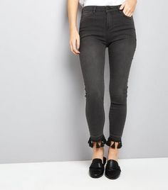 Petite. Update your denim collection with these tassel hem jeans. Pair with a simple t-shirt and loafers to complement.- Belt loops- Classic 5 pocket design- Button and zip fly fastening- Tassel trim hem- Soft cotton blend- Skinny for a close cut fit- Jo wears UK 10/EU 38/US 6 Petite size guide:UK size 4: Bust - 78cm, Waist - 60cm, Hips - 84cmUK size 6: Bust - 80cm, Waist - 62cm, Hips - 86cmUK size 8: Bust - 84cm, Waist - 66cm, Hips - 90cmUK size 10: Bust - 88cm, Waist - 70cm, Hips...