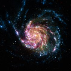 A Pinwheel Galaxy Rainbow - The Pinwheel Galaxy is in the constellation of Ursa Major (the Big Dipper). Also, before the area of sky was though to be void of any galaxies at all because it was so dark. Thank you hubble space telescope! Space Photos, Space Images, Pinwheel Galaxy, Rainbow Galaxy, Carl Sagan Cosmos, Spitzer Space Telescope, Nasa Space, Galaxy Space, Telescope Craft