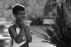 A young boy in Nablus, in the Palestinian territories, watching a soccer game. He was too shy to join the game. Taken for Tomorrow's Youth Organization. photography-for-social-change
