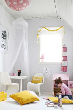 Love this clean palate with a pop of color for a kid's room...plus what little girl wouldn't want 2 Panton S Chairs in her room??
