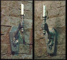 Miniature 1:12th scale  Castle Wall Sconces  by Creager Studios... the old movie Beauty and the Beast by Jean Cocteau had these lining the walls, and they moved!