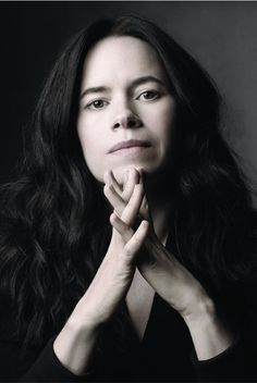 Natalie Merchant from her latest Leave Your Sleep album (before she let her hair go natural).  Love her!