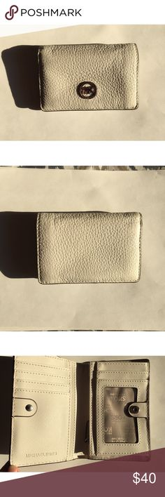 Authentic Michael kors short white wallet Soft leather great condition Wallet. Please be notice that there are some tiny dark spots on the back side, which is shown as the last pic. Only visible when you look at it hard. Michael Kors Bags Wallets