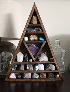 Fan of stones, crystals and shells? Show them off in a unique open cabinet. // via stoneandviolet
