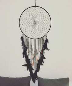 Giant DIY dream catcher with Lady Amherst Pheasant feathers.