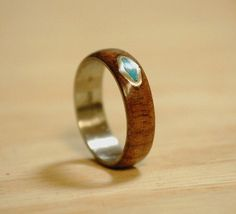 This ring is Yucatan Rosewood with Silver/Turquoise Triangle Inlay. Additional…