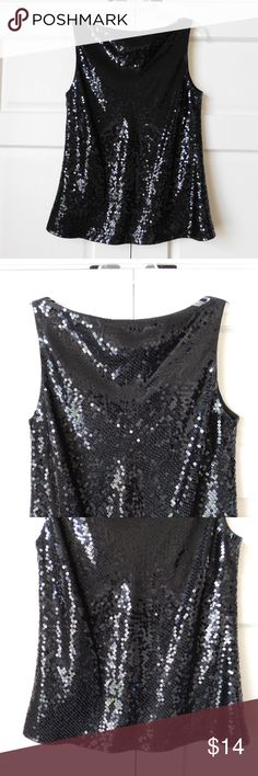 "Ann Taylor Black Sequin Sleeveless Tank Top Sz 8 Condition: Excellent Used Condition; no stains or snags; is not missing any sequins; Please see pictures Color: Black Size: 8 Measurements laying flat (approximate): Chest 18.5"" Waist 18"" Hem 21.5"" Total Length 22.75"" Made in China  Material: 100% Polyester  Thank you for looking! Please ask all questions before buying. Please view the pictures as they are a large part of this description!  All things come from a smoke-free home. Ann Taylor…"