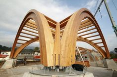 Glulam wooden truss Lamella CNC-arched trusses with ridge joints and a purlin layer on top 3S-sheets and aluminium roofing