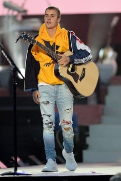#MostWantedLooks: Justin Bieber performing at One Love Manchester wearing Purpose Stadium Tour Hoodie, Opening Ceremony Jacket, Amiri Jeans and Cream White Yeezys