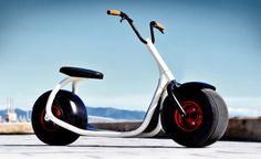 The Scrooser, a hybrid vehicle that looks like a cross benween a Vespa and a Segway
